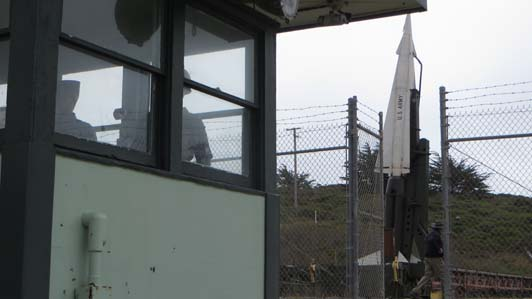 Guard shack and missile in launch position.
